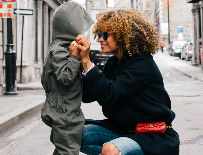 Woman crouching and smiling with her son